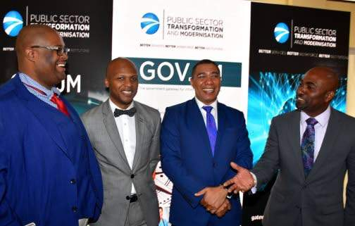 Prime Minister, Andrew Holness (second right), laughs at a joke made by Science, Energy and Technology Minister Dr Andrew Wheatley (right) at the official launch of the GOV.JM web portal at the Office of the Prime Minister in Kingston. Others (from left) are Chairman of the eGov Jamaica Limited Board, Dr Lloyd Waller; and Principal Director of the Public Sector Transformation and Modernisation Division in the Cabinet Office Wayne Robertson.